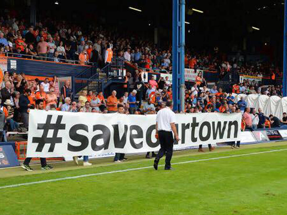 #saveourtown banner on display at kenilworth road