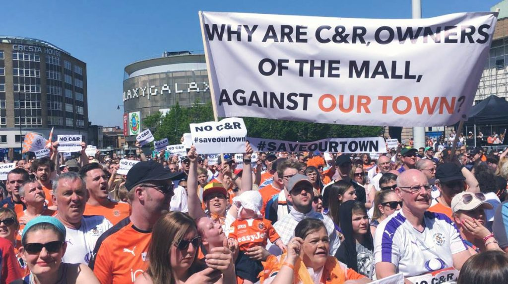 Luton Town FC supporters demonstrate against Capital & Regional during the club's civic ceremony in St George's Square in May 2018, after securing promotion to League One